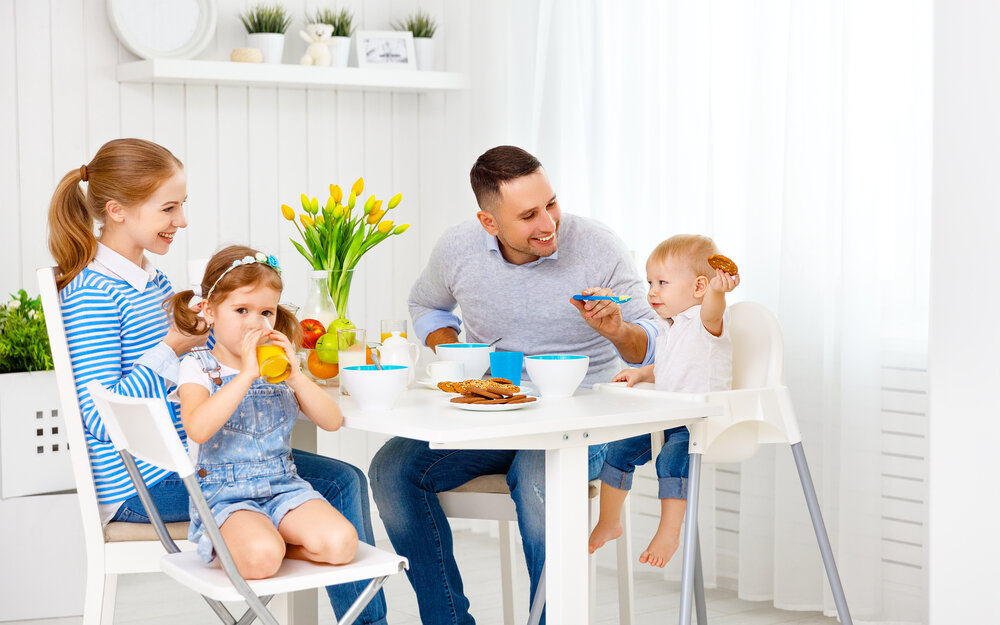 family sat at the table eating together