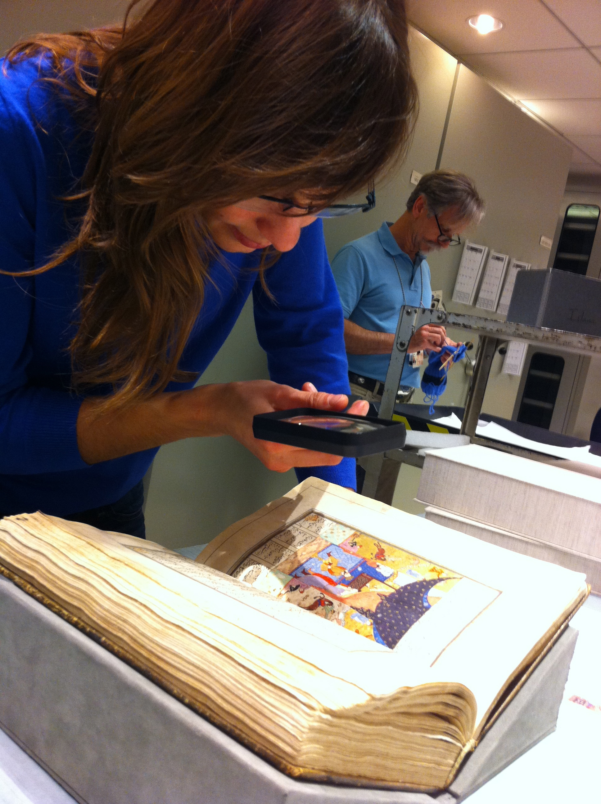 Viewing a 15th century Khamsa of Nizami manuscript in the archives of the Metropolitan Museum of Art in New York.