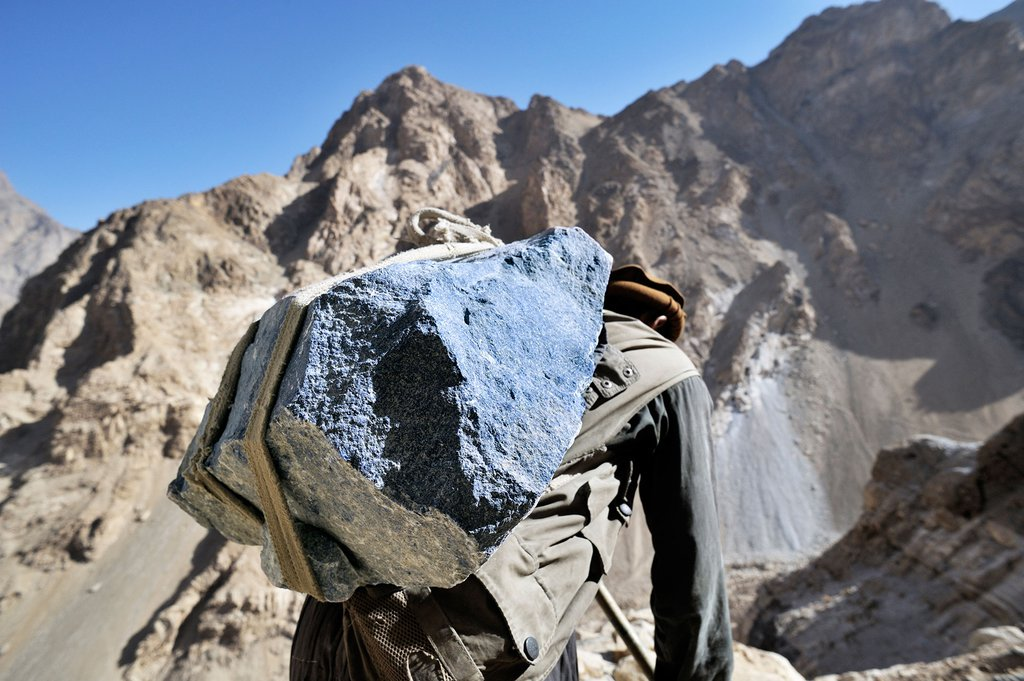 Lapis lazuli stone being carried by a miner in Afghanistan.