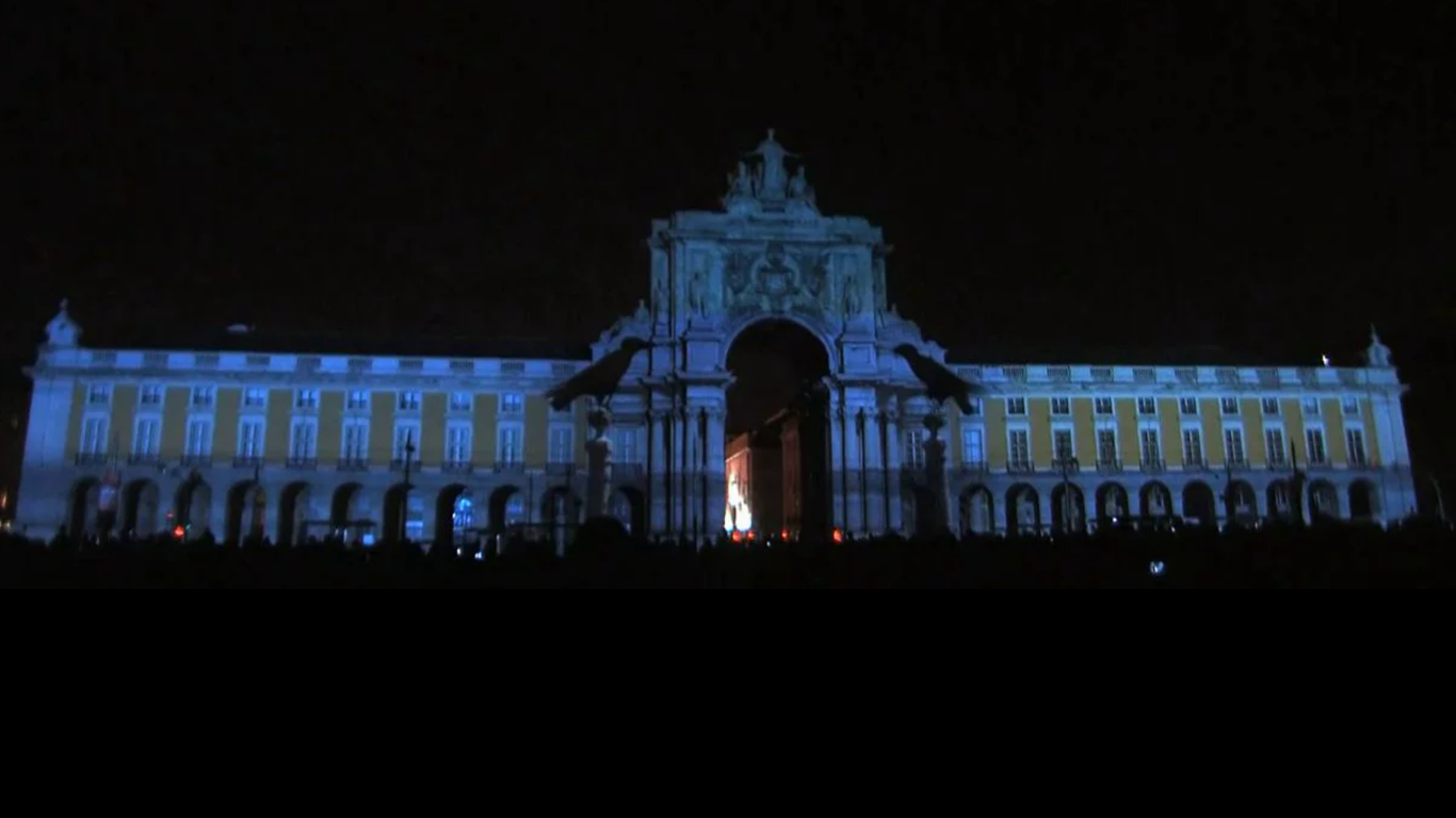 """Praça dos Cidadãos - [Citizens Square]In 2010, we celebrated Lisbon. To commemorate the century of the Republics foundation, Iniziomedia created an elaborate and majestic 3D video mapping show with the Tagus river as background. Projected onto the front of the most historical buildings of Terreiro do Paço, the """"Citizens Square"""" lit the lisbon night with stories of the big events of the city since 1755, the year Lisbon fell apart to be raised again."""