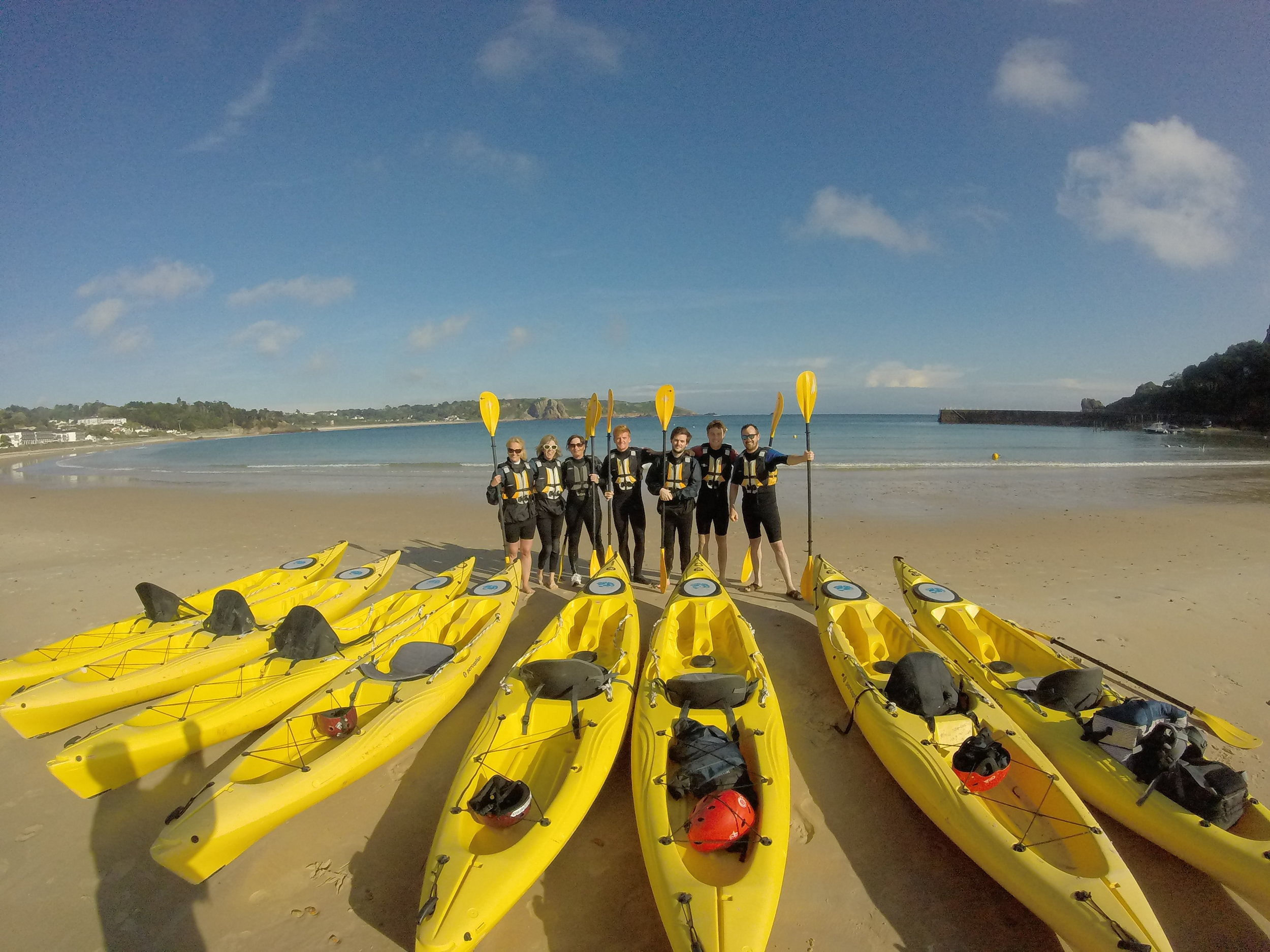 Corporate group about to depart St Brelades Bay. They paddled to Beau Port to watch the sun go down and enjoyed a cold beer and some wine.