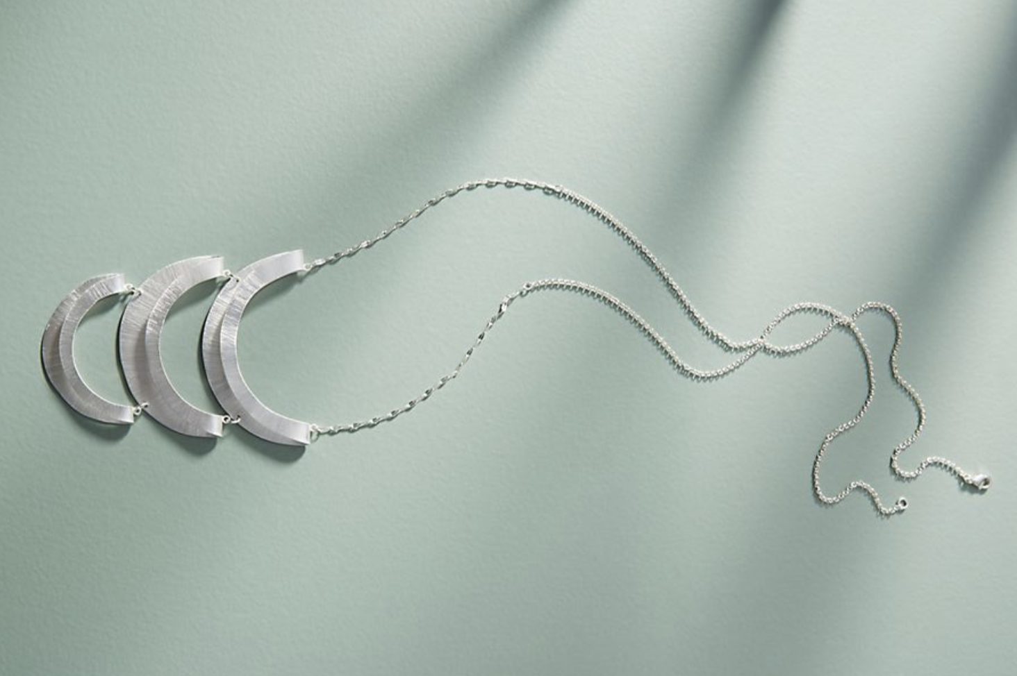Crescent Pendant Necklace by  Anthropologie