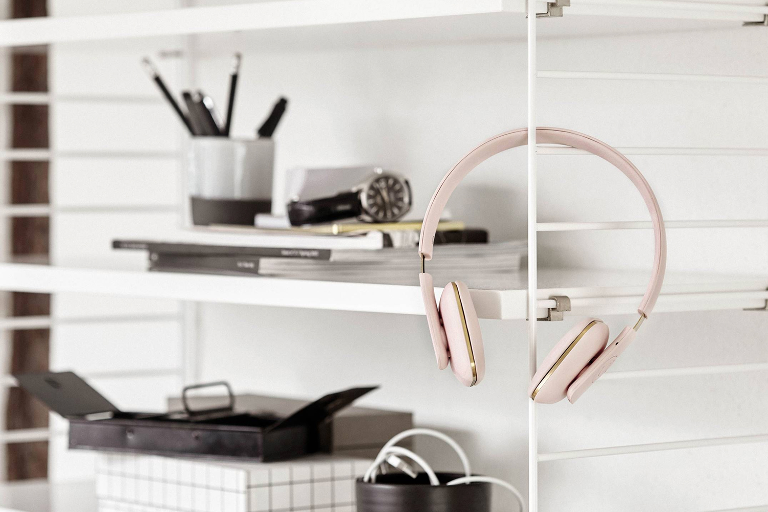 Minimal pastel pink aHEAD headphones from  Kreafunk .