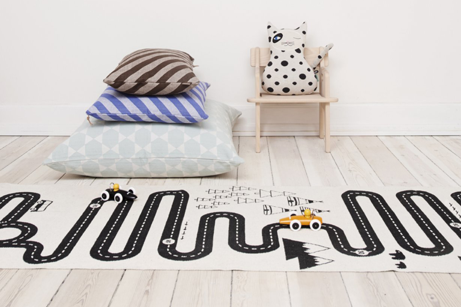 The playful Circuit Adventure rug, designed by OYOY and sold by  Les Enfants du Design .