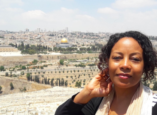 I am sun-soaked before visiting the Old City and the Mount of Olives - in Jerusalem in June 2019.