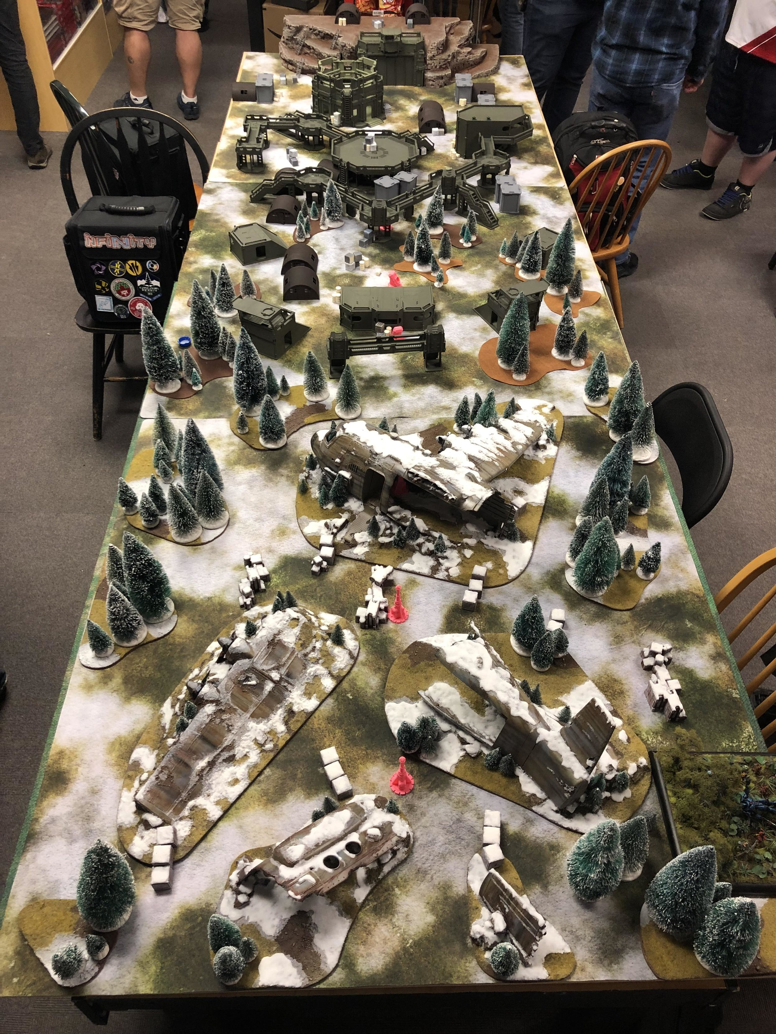 The whole scene, a plane crash, base, and mountain stronghold.