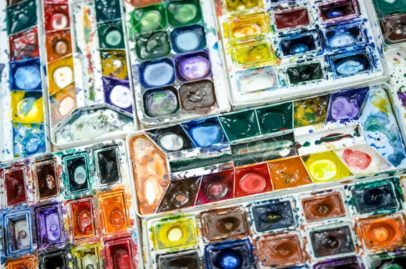 108293450-watercolor-dirty-palette-in-painting-studio.jpg