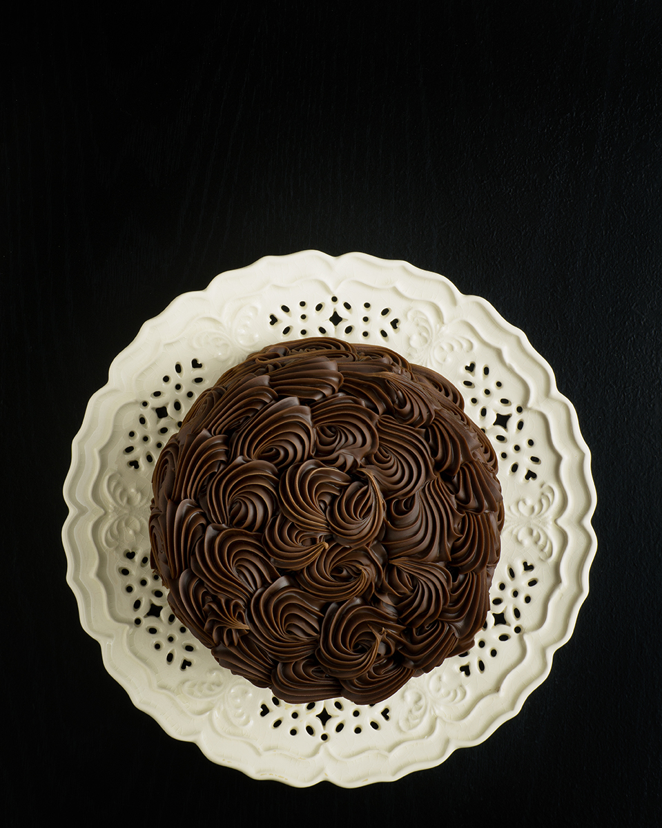Chocolate cake on lace plate