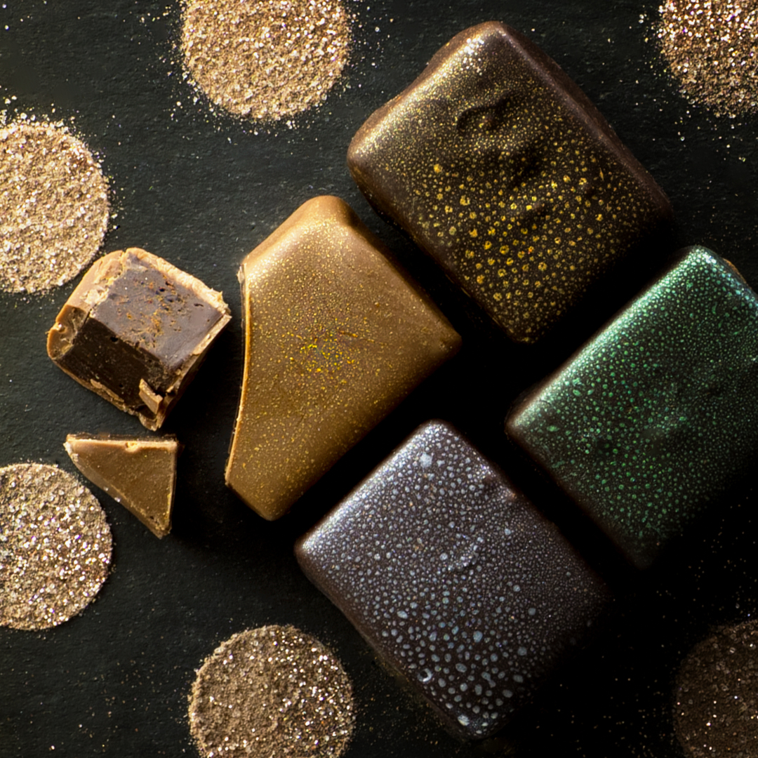 Artisan chocolates on black and gold