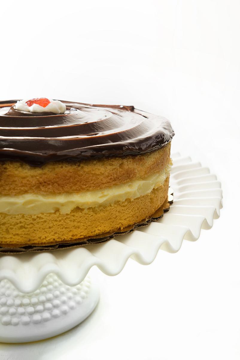 Boston cream pie on cake stand
