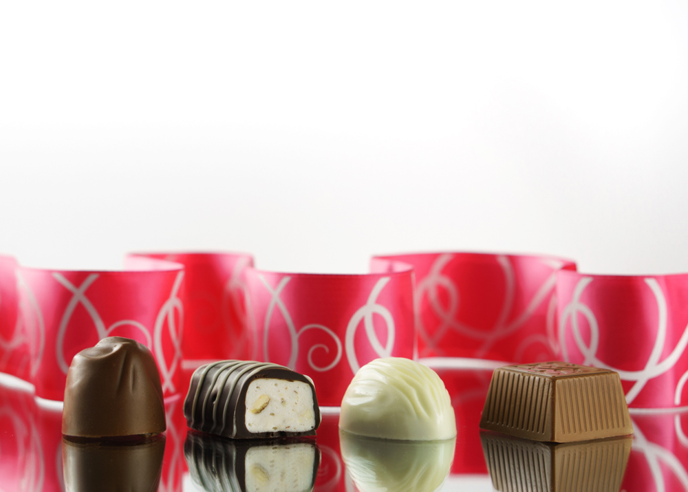 Chocolate candies on mirror
