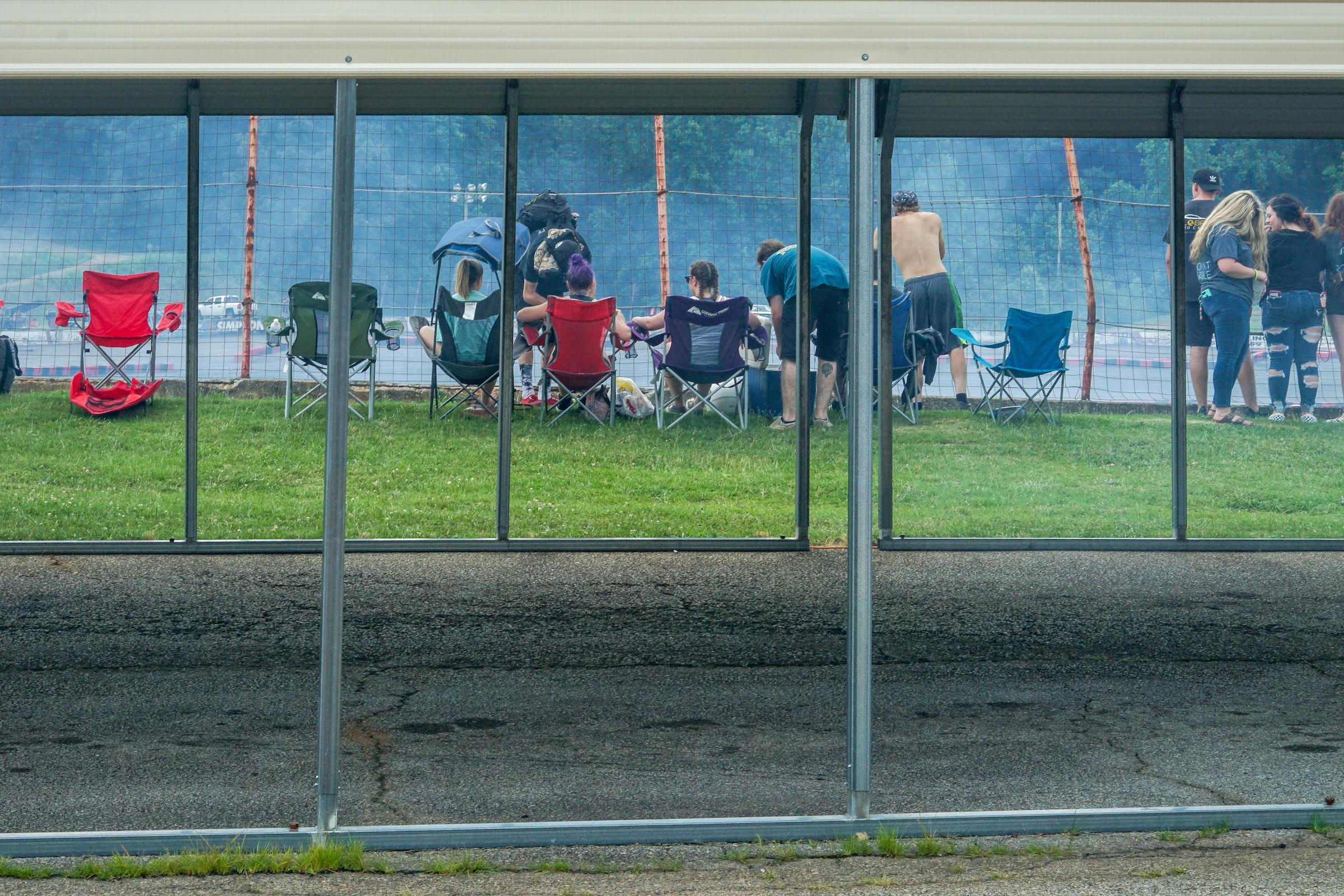 Spectators and smoke.