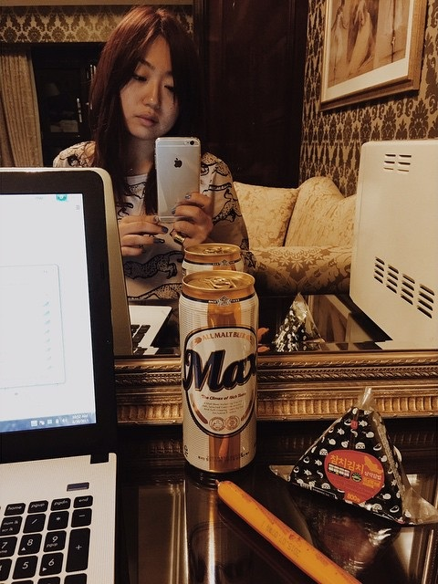 Me working alone in my hotel room on a business trip to Seoul in 2015.