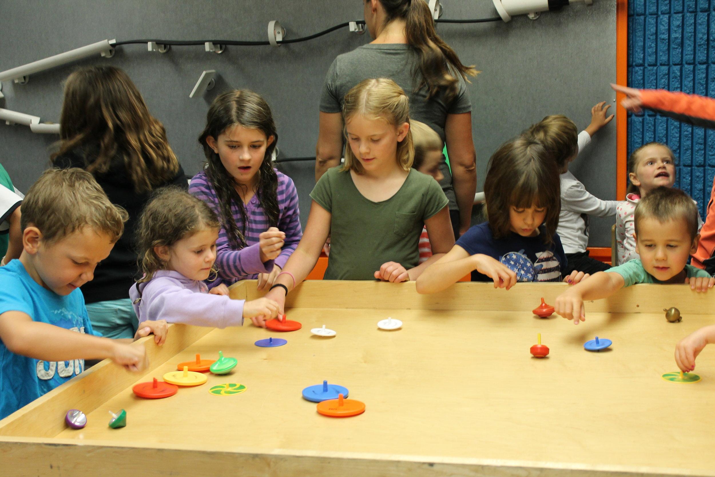 17.4.27 kids spinning tops.JPG