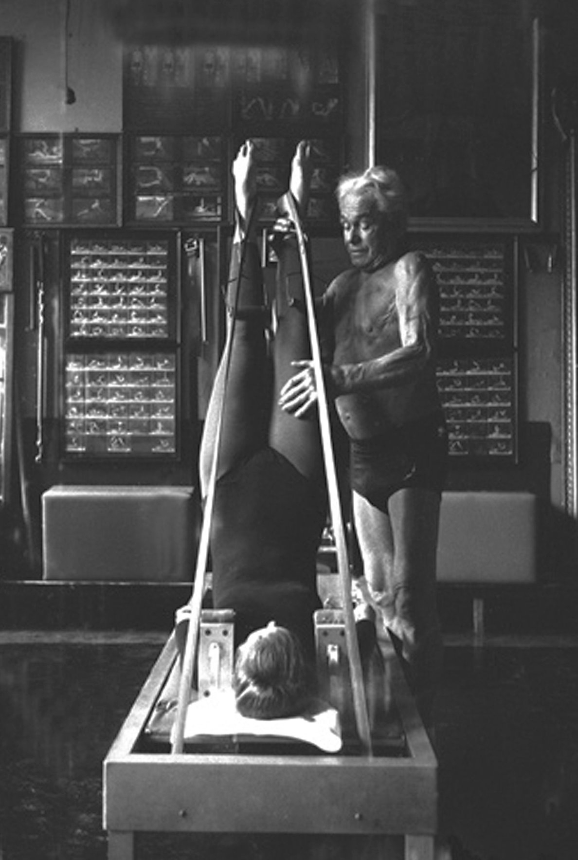 Joseph pilates - Joseph Pilates was born in Mönchengladbach, near Düsseldorf, Germany, in 1883. His father was a prize-winning gymnast, and his mother worked as a naturopath. Pilates was a frail sickly child, suffering from asthma, rickets and rheumatic fever. His drive and determination to overcome these ailments led him to become a competent gymnast, diver and skier. He also studied body-building, yoga and kung fu.In 1912 Pilates moved to England, earning a living as a professional boxer, circus performer, and self-defence instructor for Scotland Yard. However, during the First World War, he was interred by the British authorities, with other German nationals, and taught them wrestling and self-defence. He developed his technique of physical fitness further, during the latter part of the War, when he served as an orderly in a hospital on the Isle of Man, working with patients unable to walk. Joseph developed his concept of an integrated, comprehensive system of physical exercise, which he himself called 'Contrology'. He attached bed springs to the hospital beds to help support the patients' limbs, leading to the development of his equipment known as the 'Cadillac'. Much of his equipment, although slightly adapted, is still in use today in many Pilates Studios.Pilates emigrated to the United States in the early 1920s, opening a 'body-conditioning studio' with his wife Clara in New York in 1926. The studio featured much of the apparatus designed to enhance his rehabilitation work. It soon became very popular, particularly with the dance community, as it offered a chance to improve technique or recover from injury. Word spread quickly and many celebrities of the day visited his studio. These included dance legends such as Ruth St. Denis, Ted Shawn, Jerome Robbins, George Balanchine and Martha Graham, as well as the actor Jose Ferrer and the author Christopher Isherwood.In 1932 Pilates published a booklet called 'Your Health' and followed this with another called 'Ret