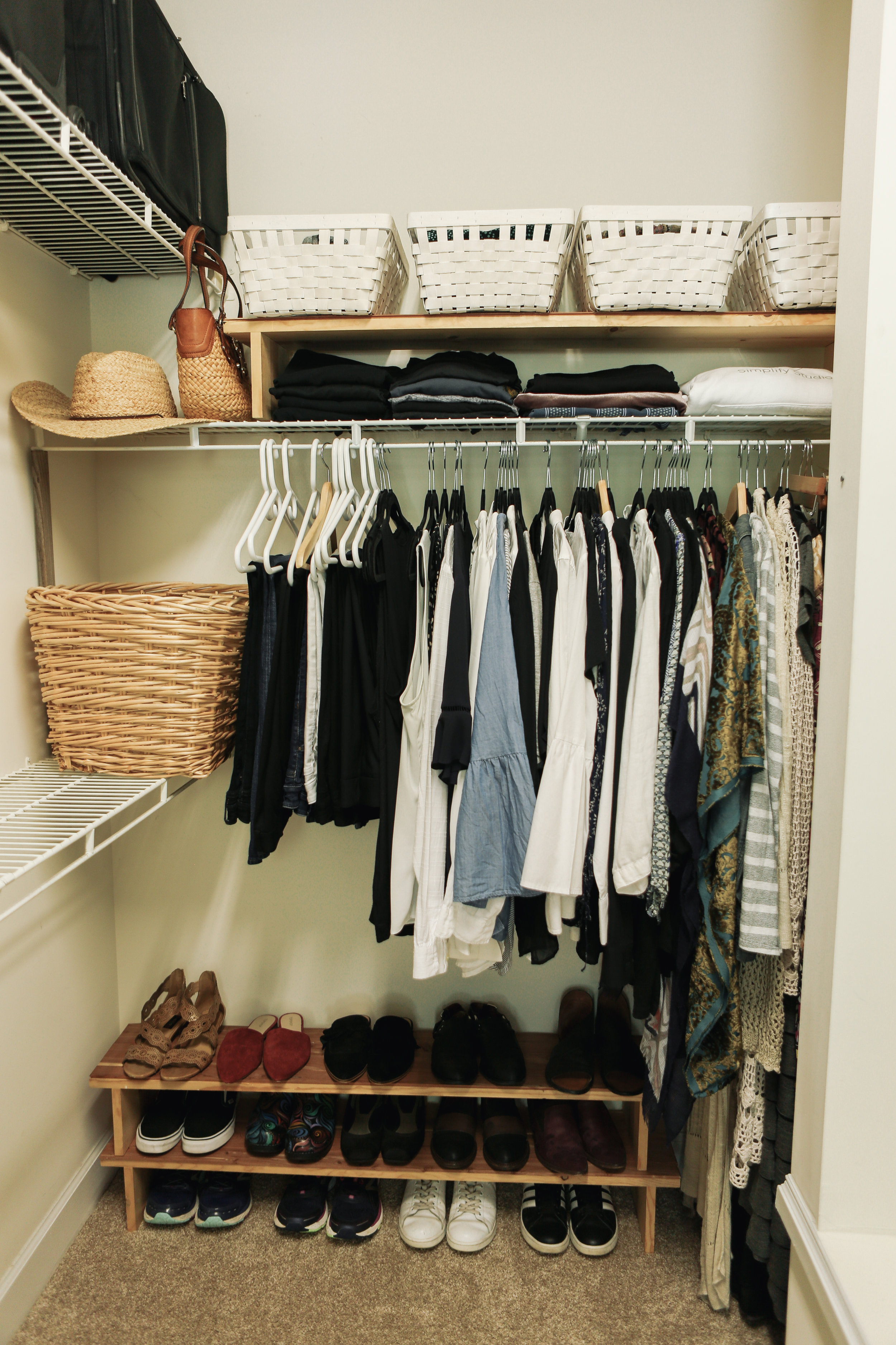 Step 2 - Next arrange like with like. Hang all pants together and group jeans together, then lightweight pants, etc. Group blazers, blouses, short sleeve tops, skirts, dresses. Group sandals, summer flats, sneakers, etc.