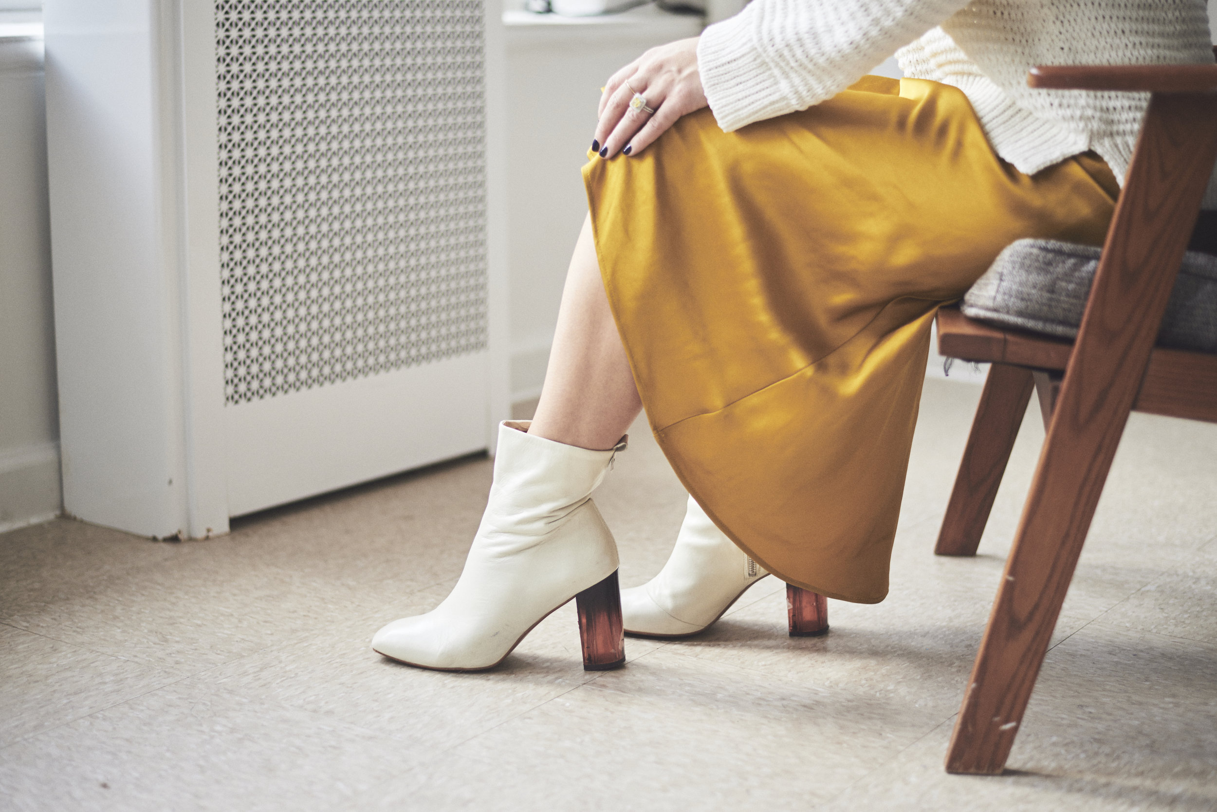 White Boots to Shop and Wear Right Now - A neutral that is anything but. A white boot makes any look a winner.Photo Credit: Emerald Baker