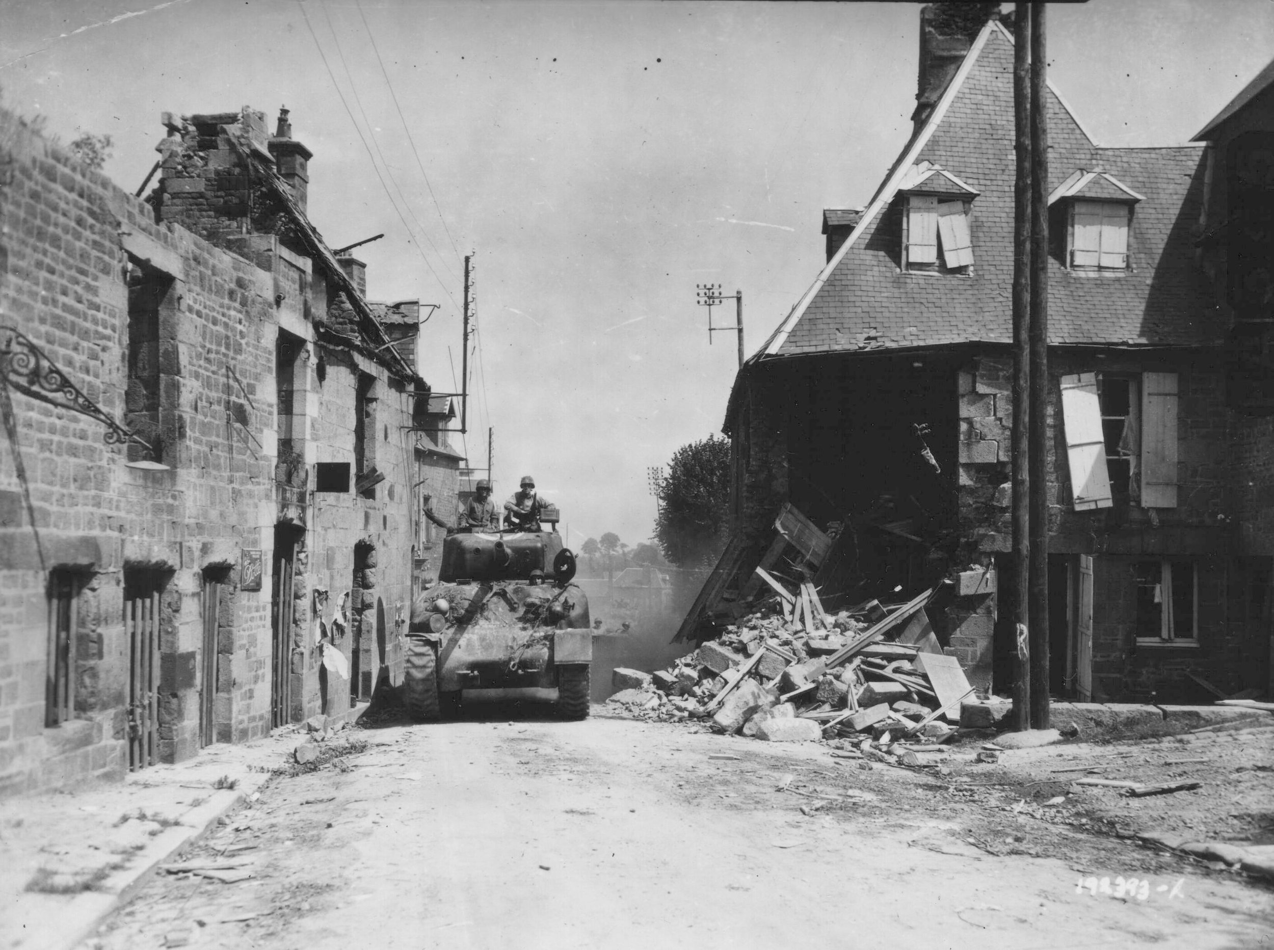 M4A1 (76) of the 67th Armored Regiment enters the village of St. Sever Calvados, France, 3 Aug 44.
