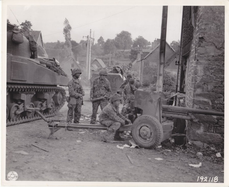 Infantry troops set up a 57 mm. gun in preparation for German counter attack. Pont Brocard, France, 29 Jul 1944.