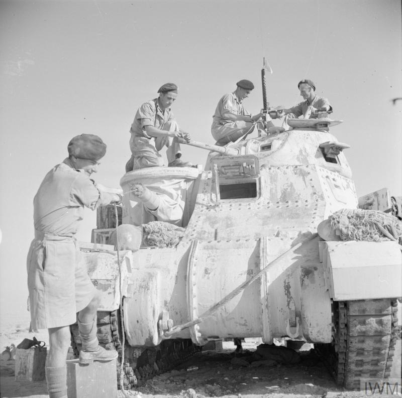 A Grant tank crew of the Staffordshire Yeomanry, 8th Armoured Brigade cleaning the guns of their vehicle, 24 October 1942.   IWM photo E 18393