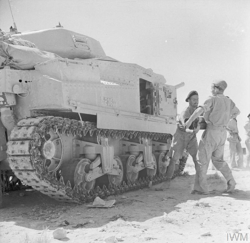 A Grant tank being loaded with ammunition before going into battle in Libya, 4 Jun 1942.   IWM photo E 12861
