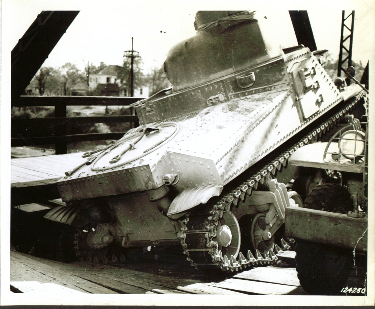 1st Army tank cracks bridge deck Monroe, NC 1941 (negative reversed - sponson gun would be on the right side)