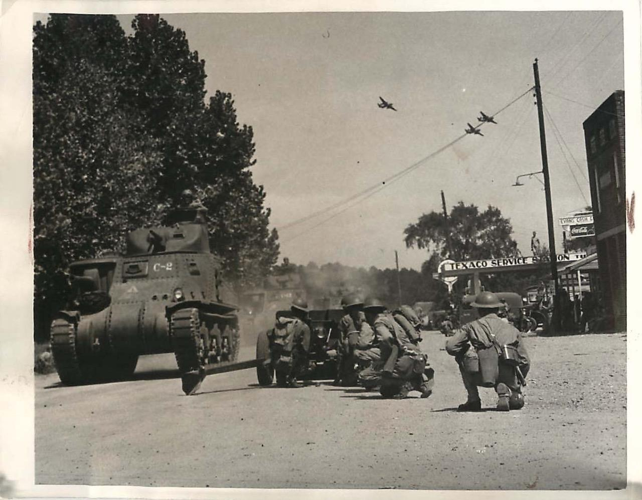 1st Armored Division M3 Lees, supported by A-20 Havocs, blast their way past defending 37mm anti-tanks guns near Castor,Louisiana, 14 Sep 1941.