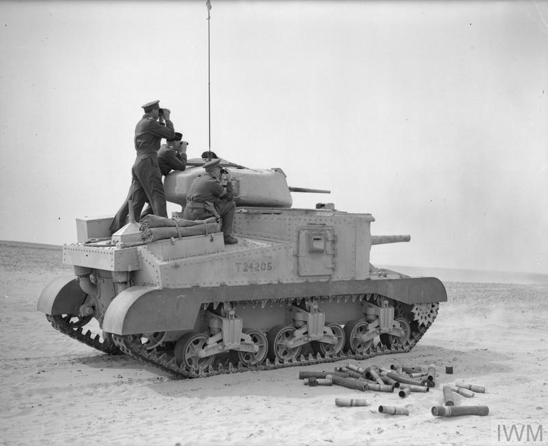 The Commander in Chief, General Sir Claude Auchinleck, (farthest from the camera) and Major General Campbell, VC, standing on a Grant tank, watching as it fires at a practice target in the Western Desert, 17 Feb 1942. IWM photo E 8458