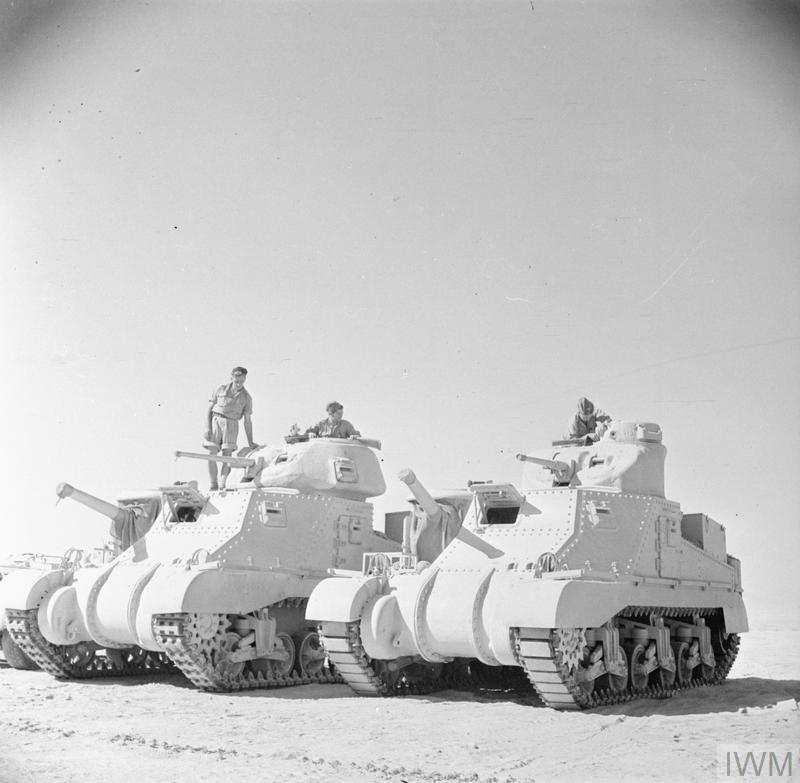 Grant and Lee tanks of 'C' Squadron, 4th (Queen's Own) Hussars, 2nd Armoured Brigade, El Alamein position. Egypt, 7 Jul 1942. IWM photo E 14053