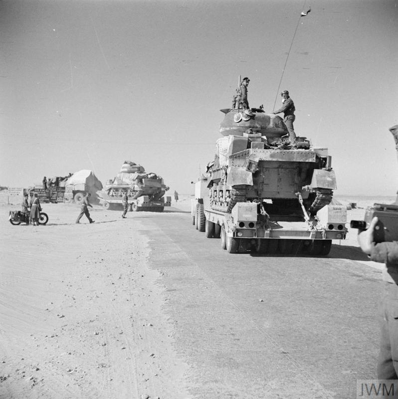 Grant tanks being carried on Diamond T 980 tank transporters along the coast road in Libya, 15 Jan 1943. IWM photo E 21272