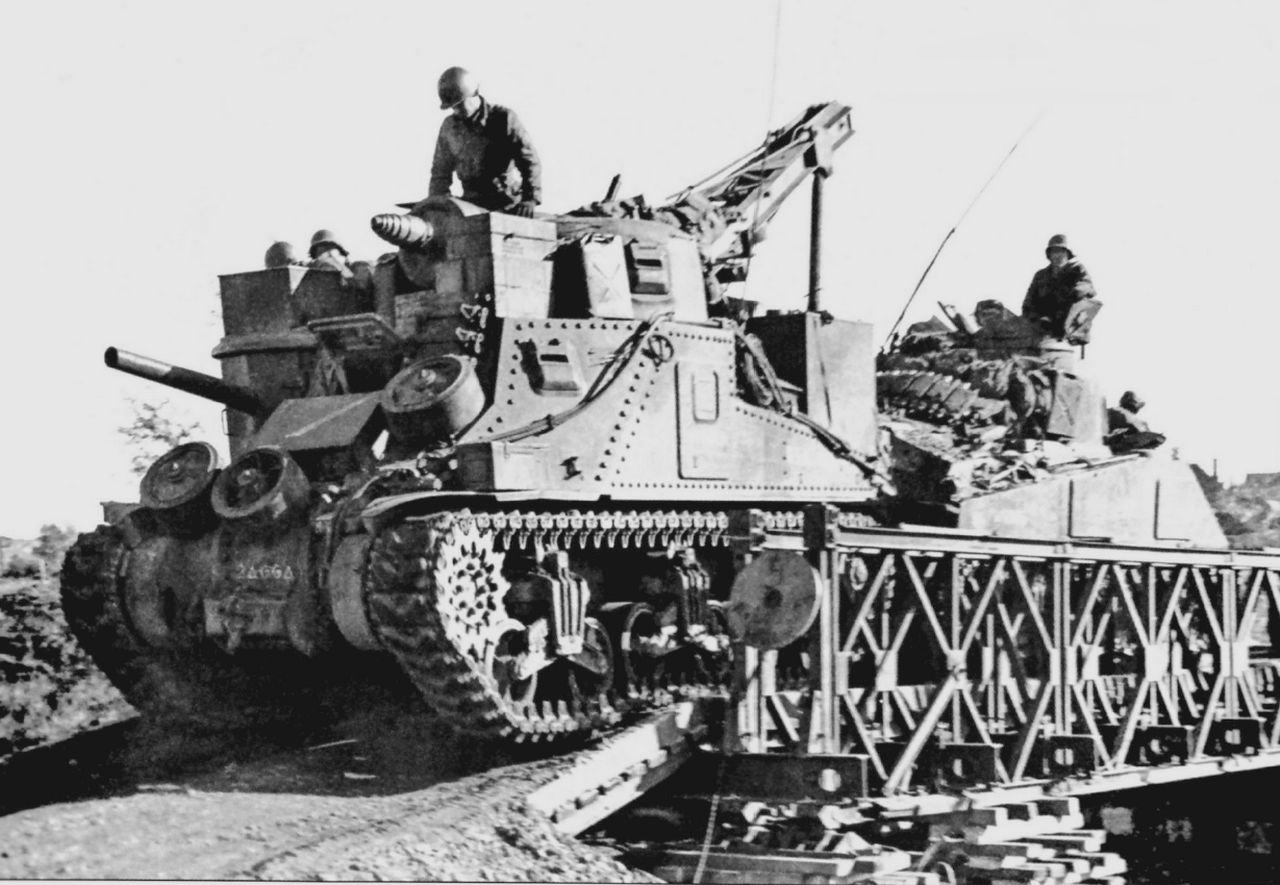 M31 from the maintenance section of Company I, 66th Armored Regiment, 2nd Armored Division, tows in an M4 Sherman tank near Palenburg, Germany.15 Oct 1944.