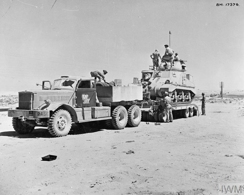 A Grant tank loaded onto a Diamond T transporter, 13 Aug 1942. IWM photo E 15577