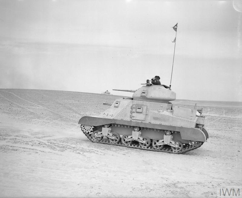 A Grant tank engaging a practice target in the Western Desert, 17 Feb 1942. IWM photo E 8476