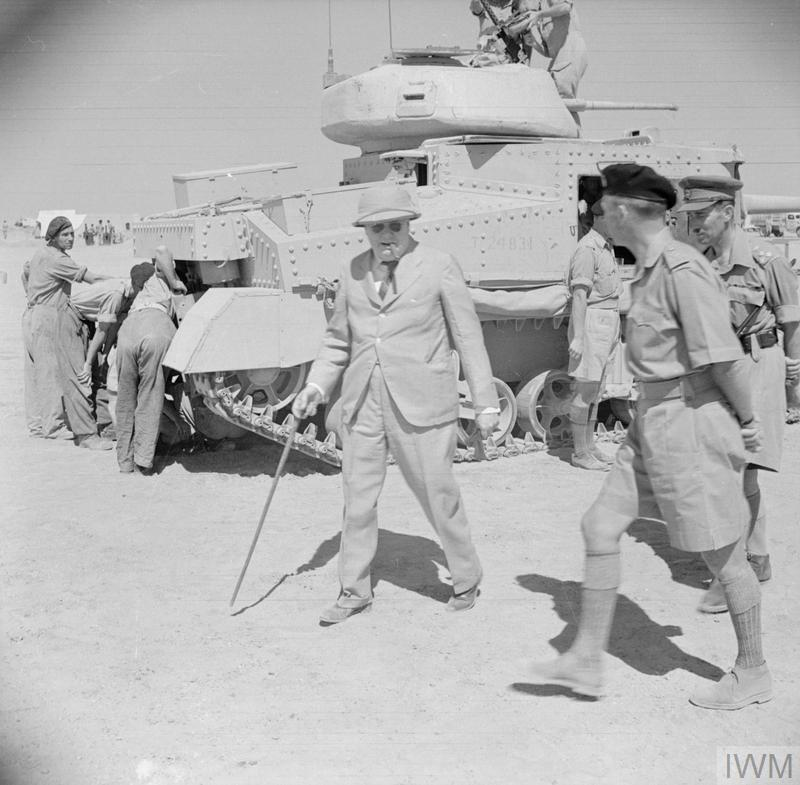 Winston Churchill touring tank units at Tel-el-Kebir, 9 August 1942. A Grant tank can be seen in the background. IWM photo E 15381
