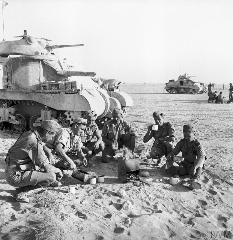 Grant tank crews sit down to a brew near their vehicles, Libya, 8 Jun 1942. IWM photo E 13106