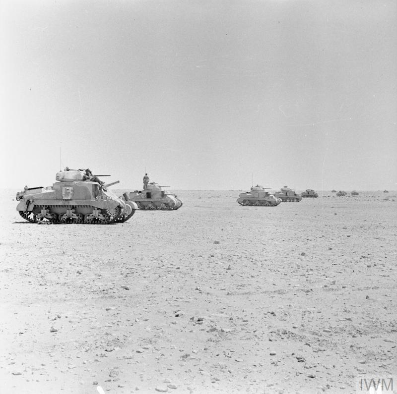 Grant tanks of 22nd Armoured Brigade, 7th Armoured Division, waiting to go into action in the Western Desert, 28 Jul 1942. IWM photo E 14948