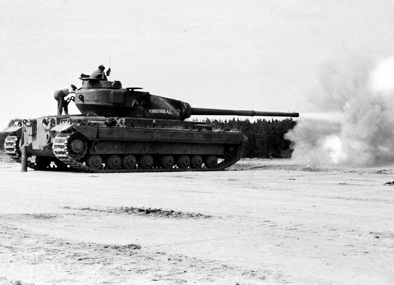 Conqueror ''CAREFREE'' of the 3rd Hussars, British Army of the Rhine, sends a round down range at the Hohne, 1956.