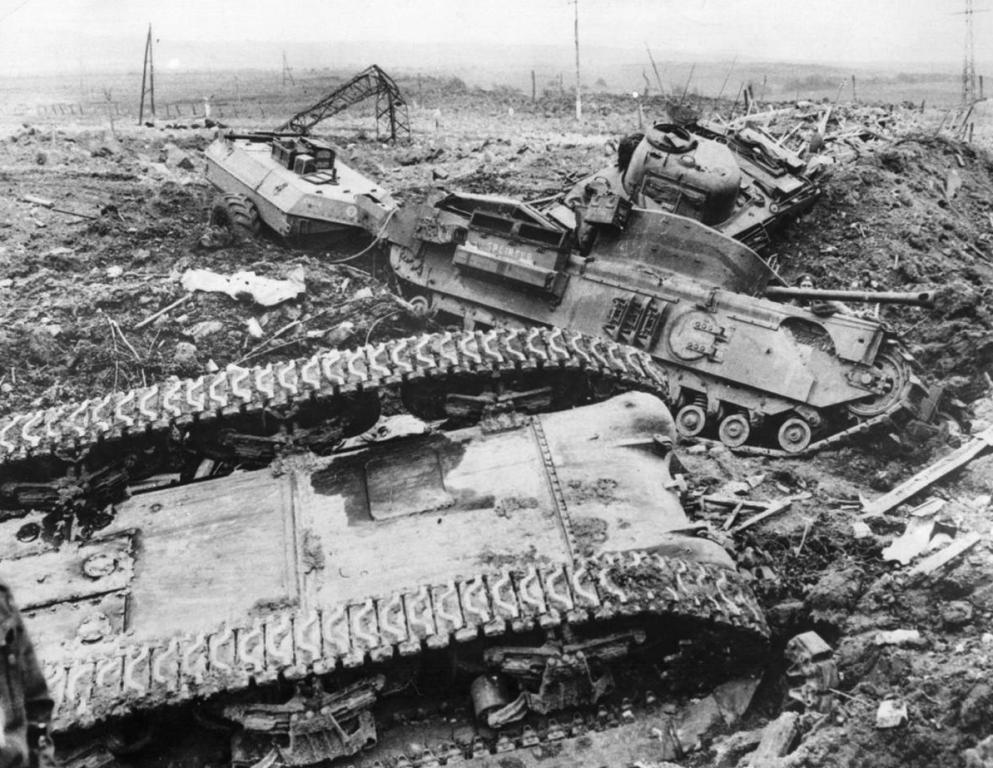 A 79th armored division Crocodile lies disabled among two knocked out 3rd Canadian Division Shermans knocked out during the Operation Wellhit, the assault on the Boulogne district,27 September 1944.
