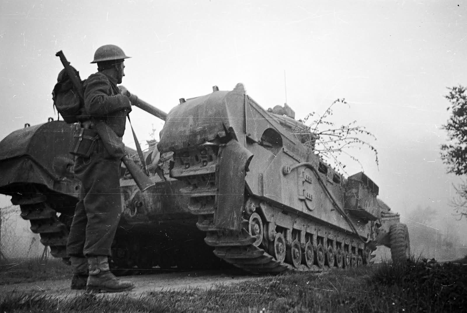 Churchill Crocodile tank and NZ soldier.Senio River, Italy, April 1945.
