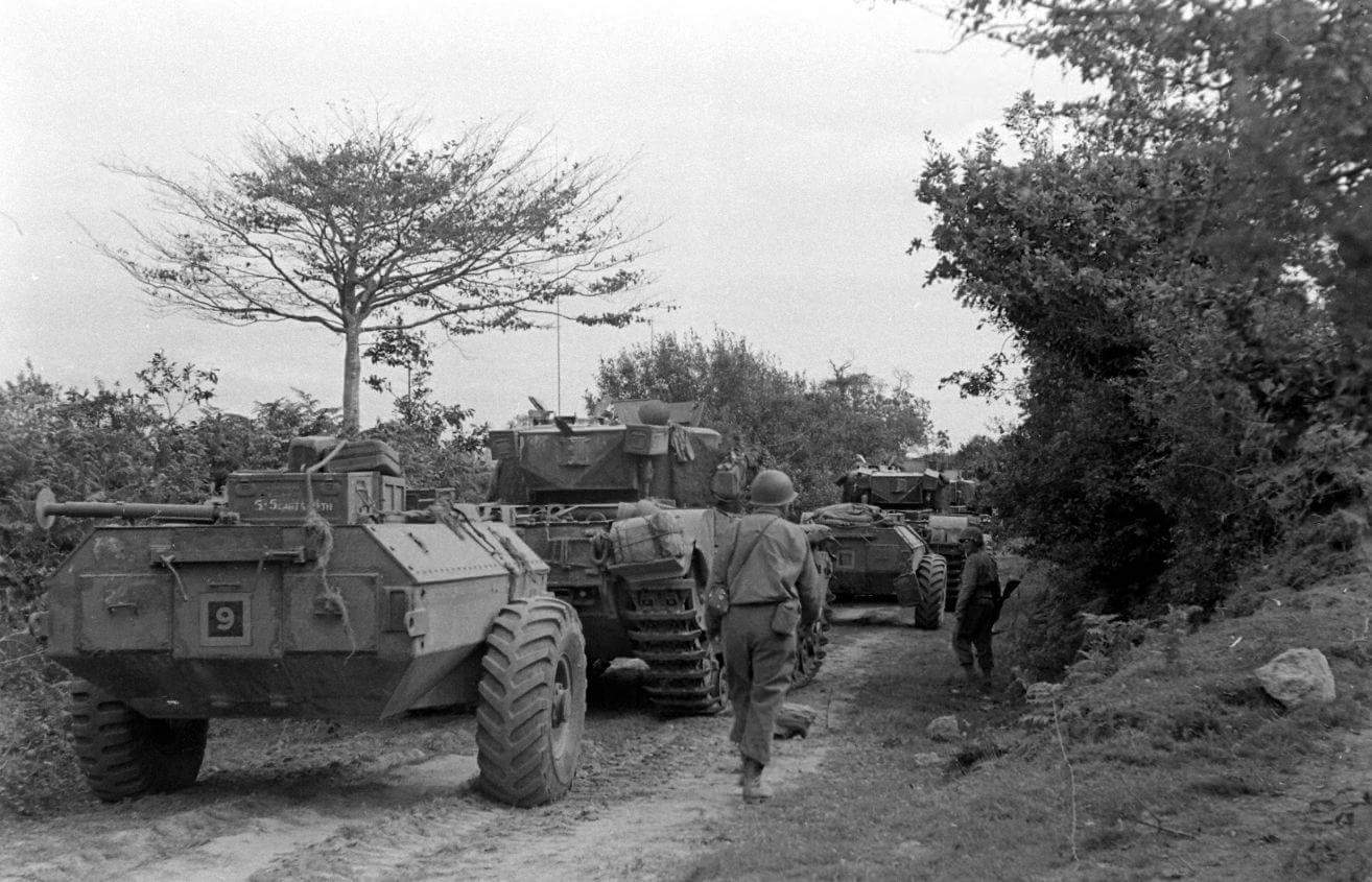 Assault force moving on Fort Montbarey.Sep 1944.