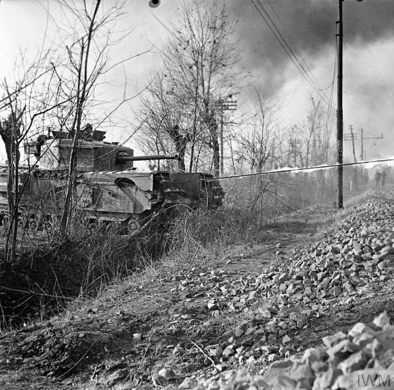 A Churchill Crocodile flamethrower in action during a demonstration near Faenza, Italy, 30 Dec 1944.IWM photo NA 21102.