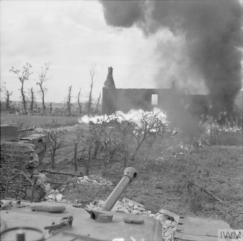 Churchill Crocodile flame-throwing tanks in action during a demonstration, 25 Aug 1944. IWM photo B 9689.