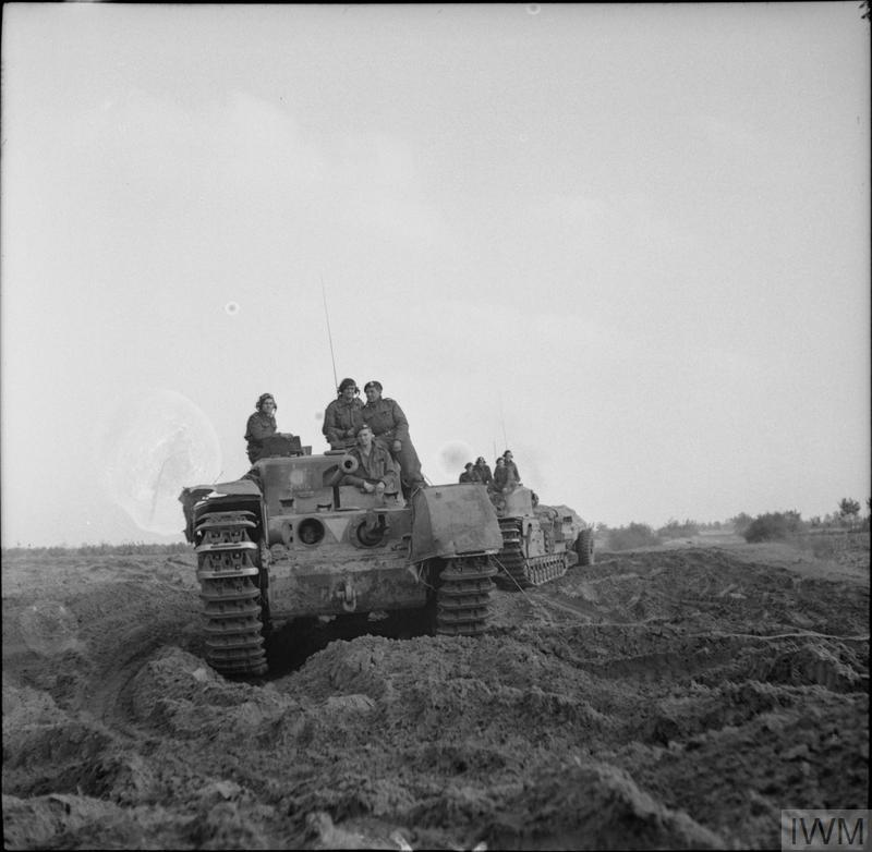 Churchill Crocodile tanks move into position during the attack towards Hertogenbosch, 23 Oct 1944. IWM photo B 11140.