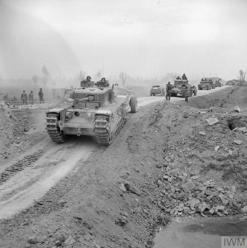 Churchill Crocodile flamethrower tanks move forward near Imola, Italy, 12 Apr 1945.IWM photo NA 24019.