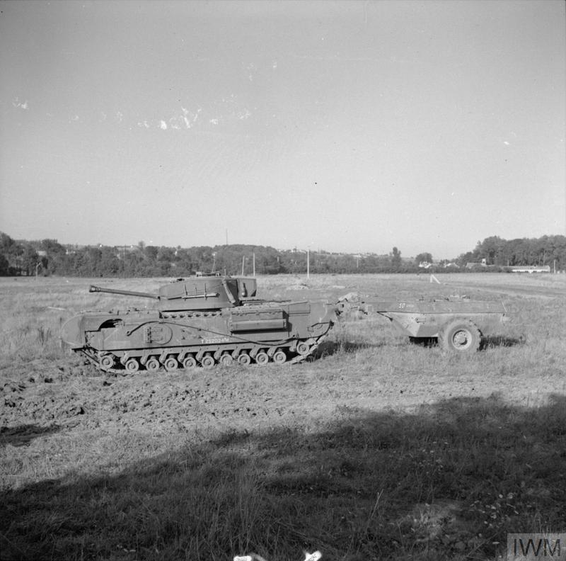 Churchill Crocodile flame-throwing tank during a demonstration, 25 Aug 1944. IWM photo B 9683.