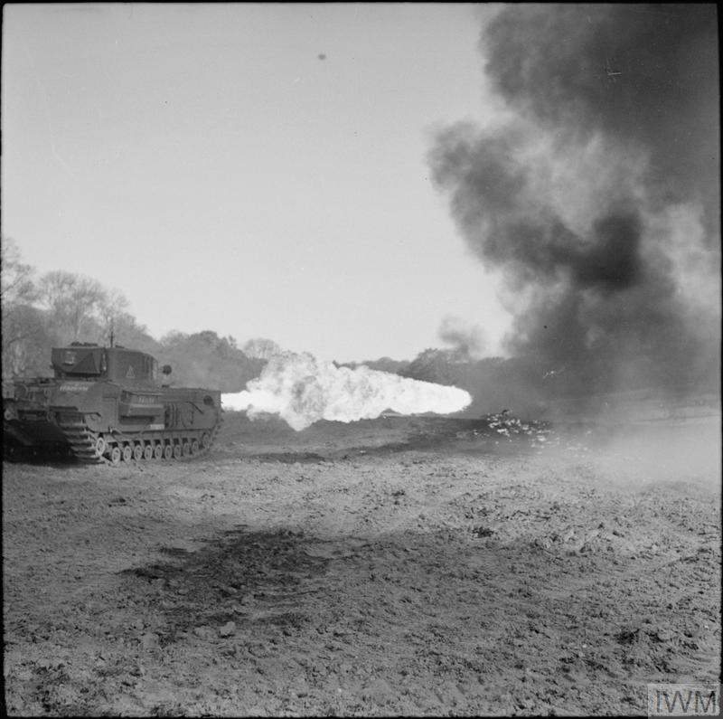 Churchill Crocodile flame-thrower in action during trials at Eastwell Park, Ashford, Kent, 26 Apr 1944.   IWM photo H 37930.
