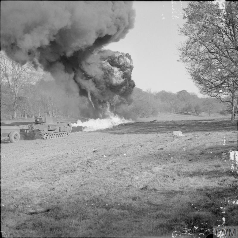 Churchill Crocodile flame-thrower in action during trials at Eastwell Park, Ashford, Kent, 26 April 1944. IWM photo H 37917.