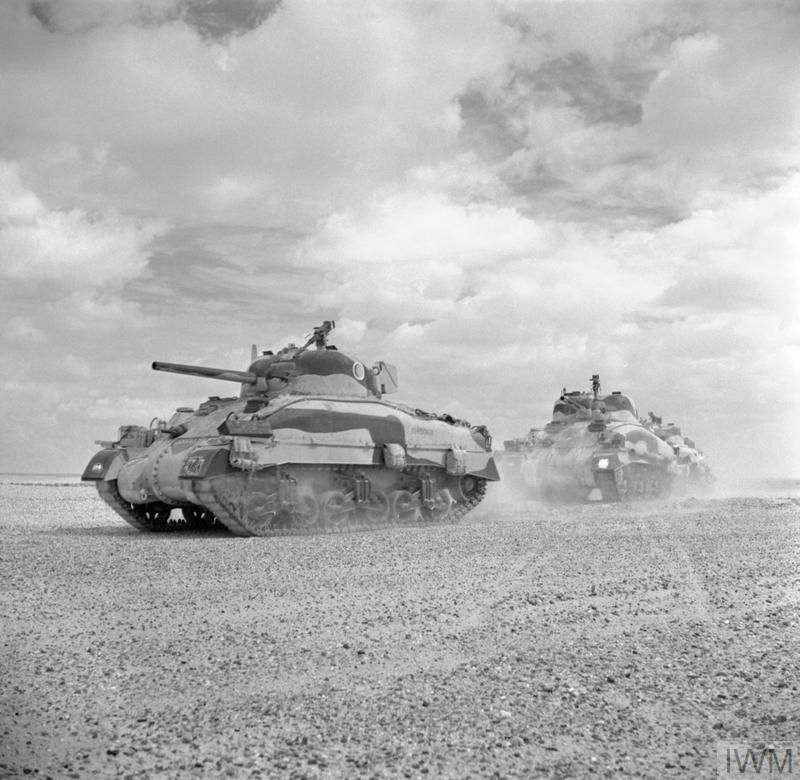 Sherman II tanks of the Queen's Bays (2nd Dragoon Guards), 2nd Armoured Brigade, moving up to the Alamein line, 24 Oct 1942. IWM photo E 18380.