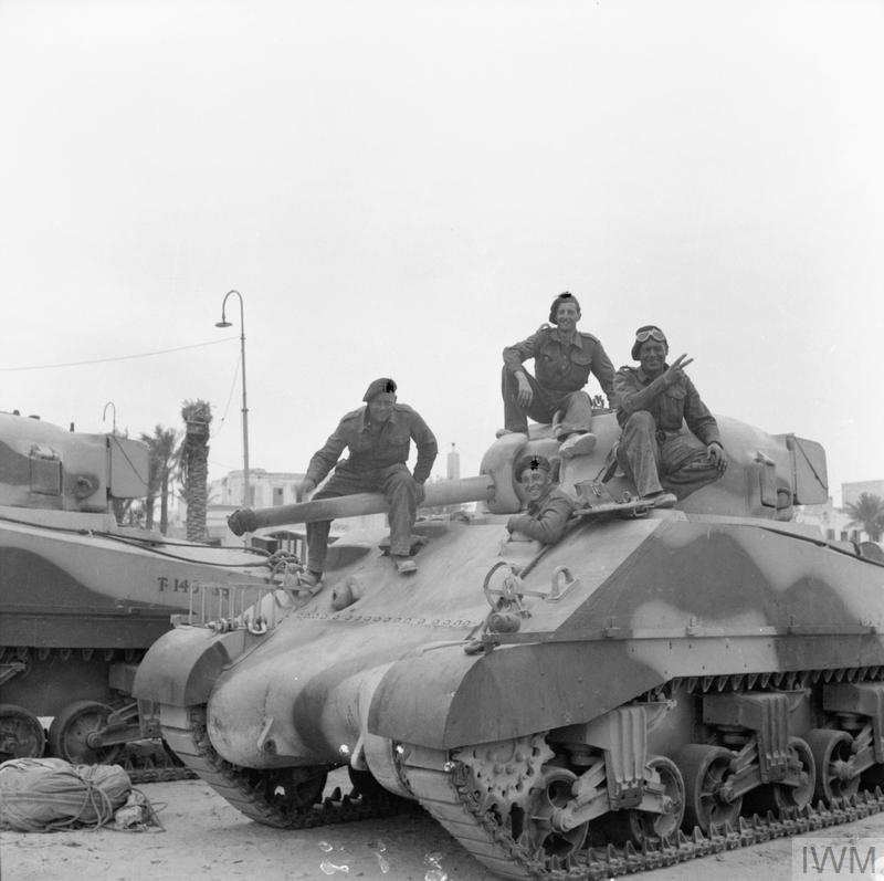 Newly-arrived Sherman tanks on the quayside in Tripoli, 15 Mar 1943. IWM photo E 22968.