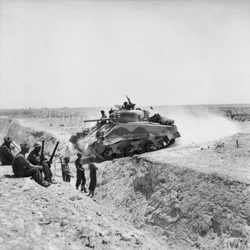 A Sherman tank crosses an anti-tank ditch during the advance through the Gabes Gap, Tunisia, 6-7 Apr 1943. IMW photo NA 1877.